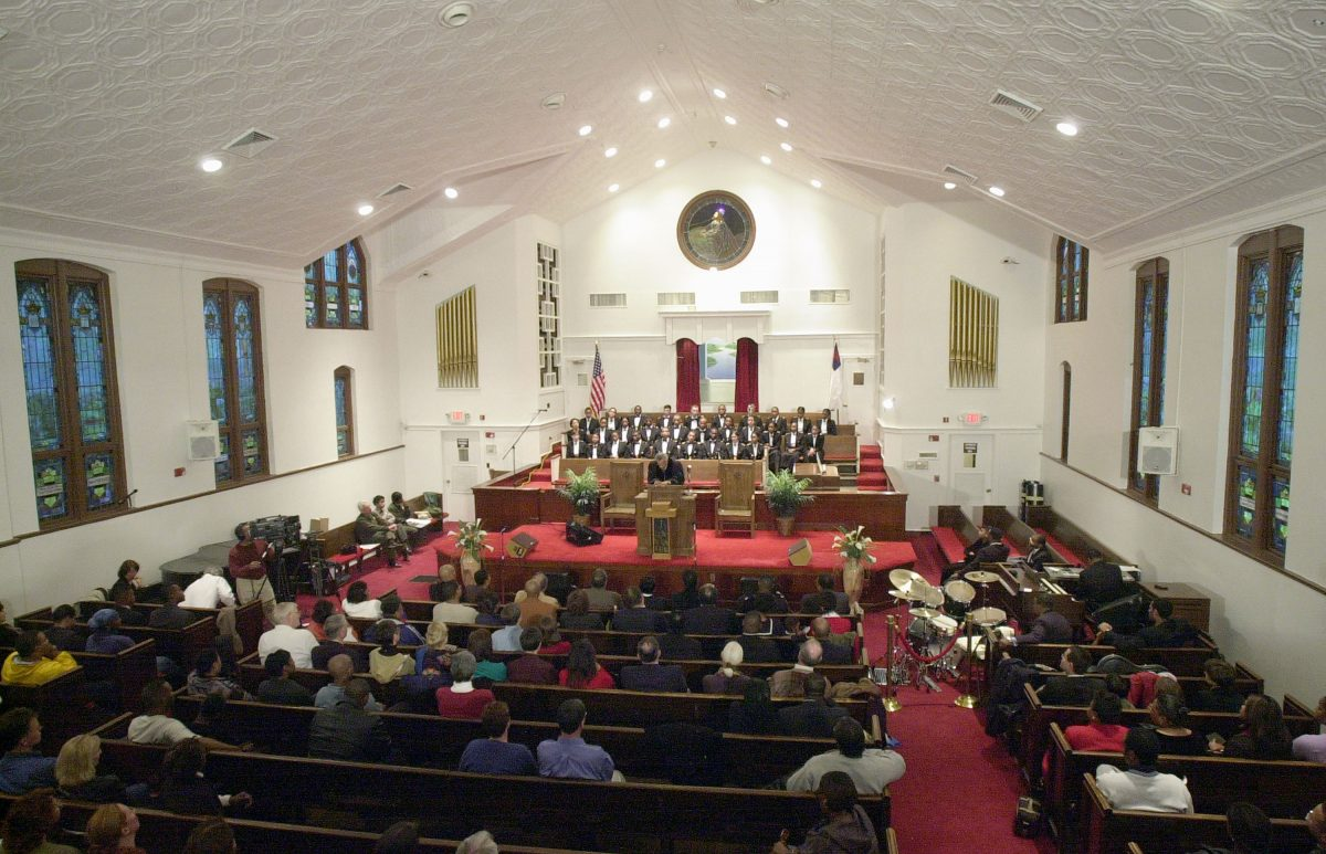 Parishioners sit inside the renovated Ebenezer Baptist Church in Atlanta, Ga., on Jan. 19, 2002. (Erik S. Lesser/Getty Images)